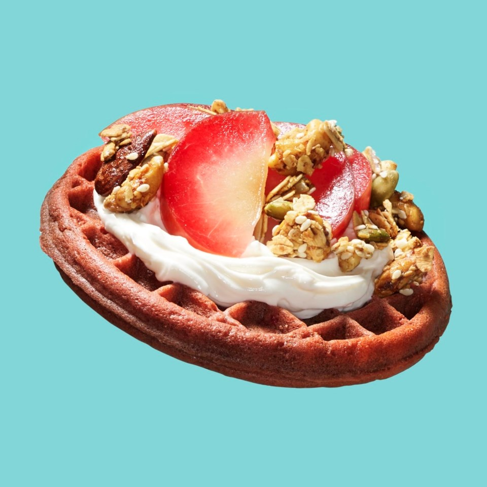 Frozen waffle with cream cheese, plums and granola
