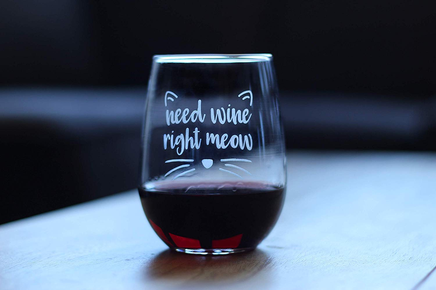 "stemless wine glass with ""Need wine right meow"" etched on it"