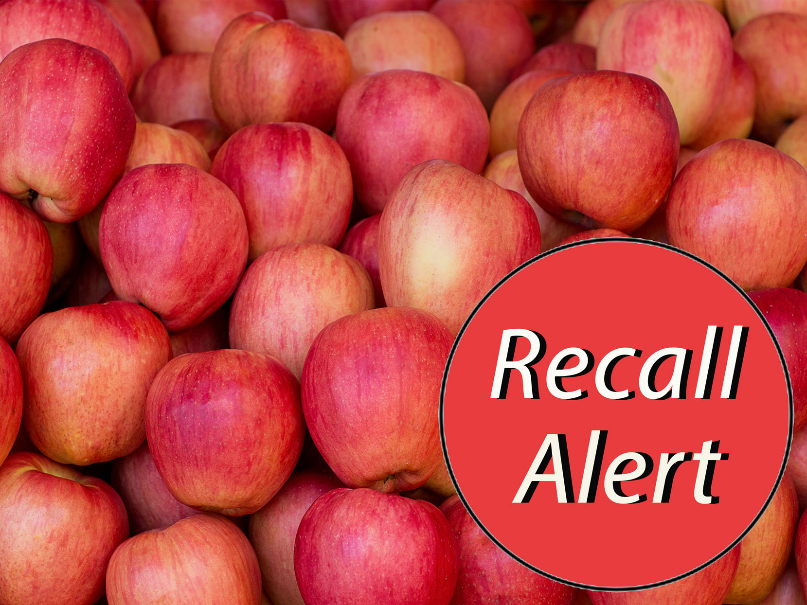 pile of apples with recall alert sticker