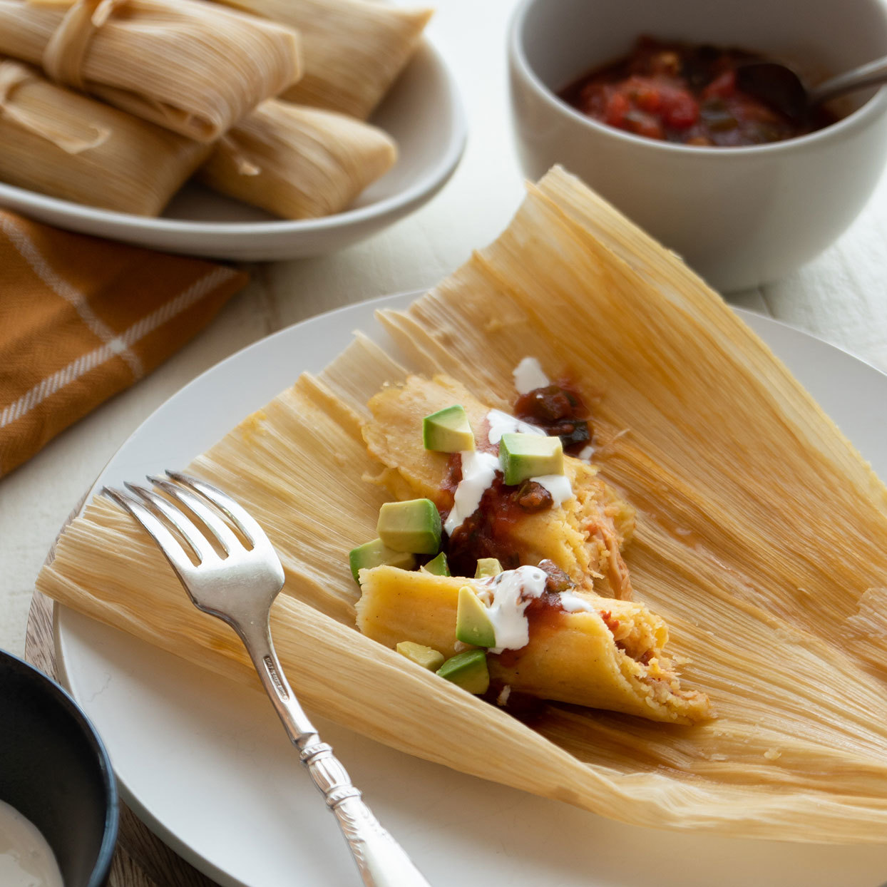 Chicken Tinga Tamales with Crema, Salsa and Avocado