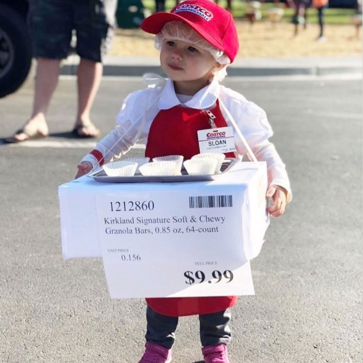 child wearing a costco sample person costume