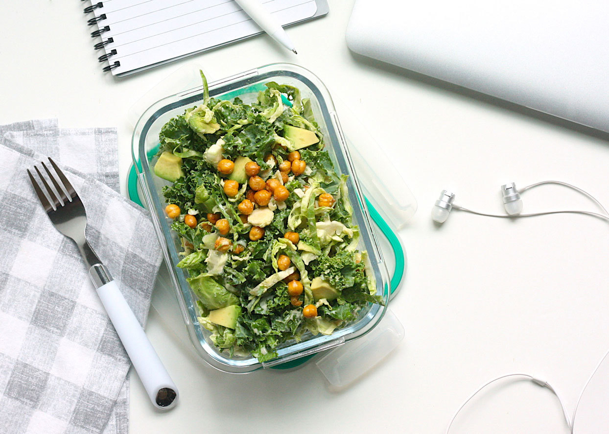 container of healthy looking salad on a desk