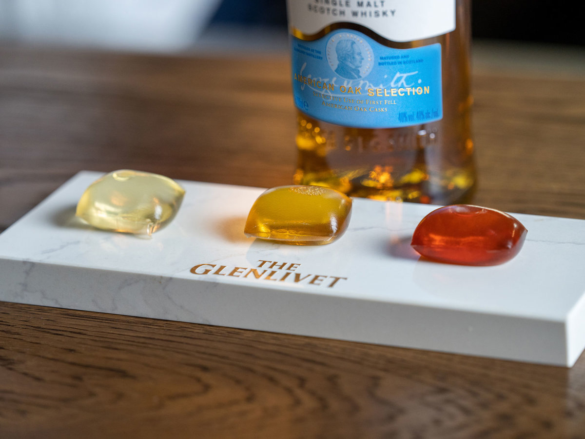 Glenlivet Scotch Whiskey Capsule Collection on a marble serving board