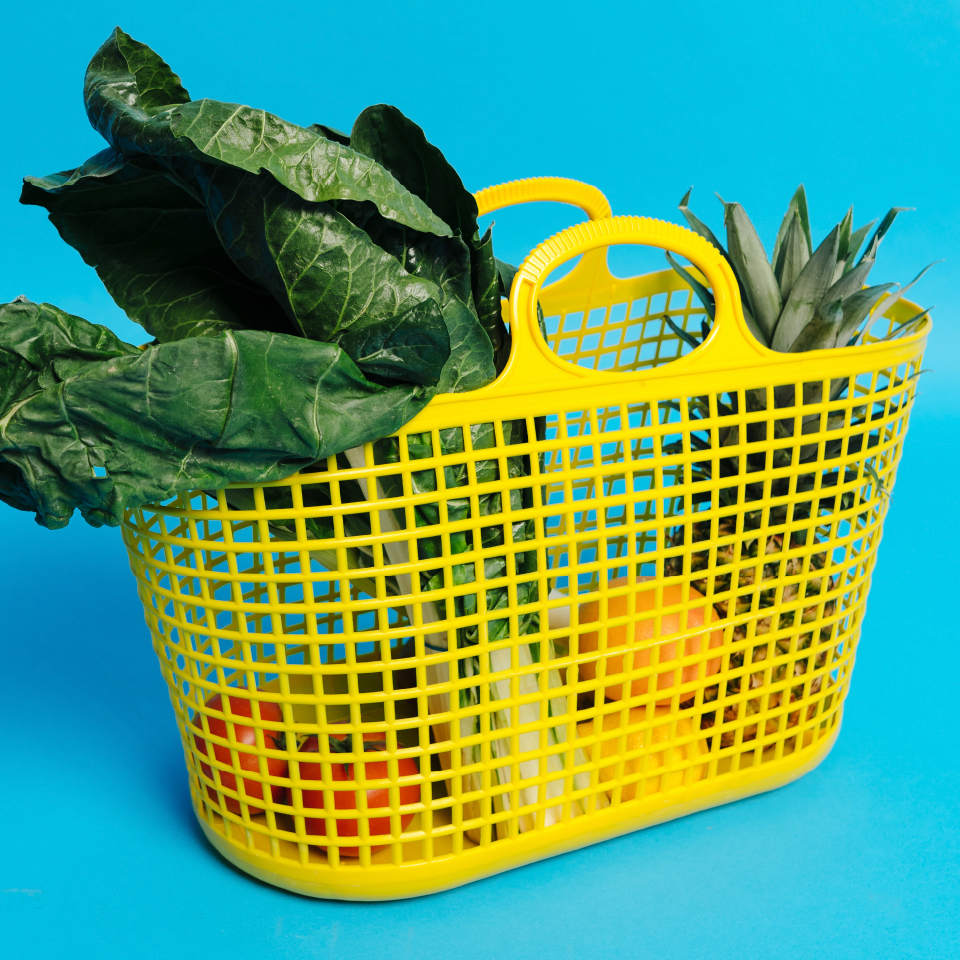 yellow plastic basket filled with produce