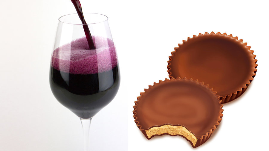 wine glass with red wine and Reece's peanut butter cups
