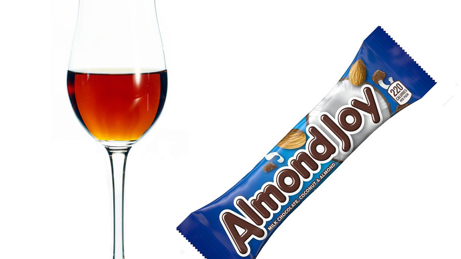 glass of sherry next to an Almond Joy bar