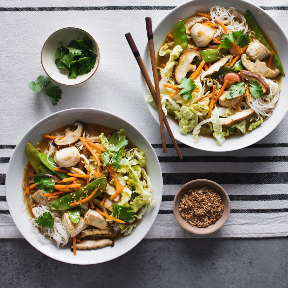 sesame-chicken-noodle-bowls-on-tablecloth
