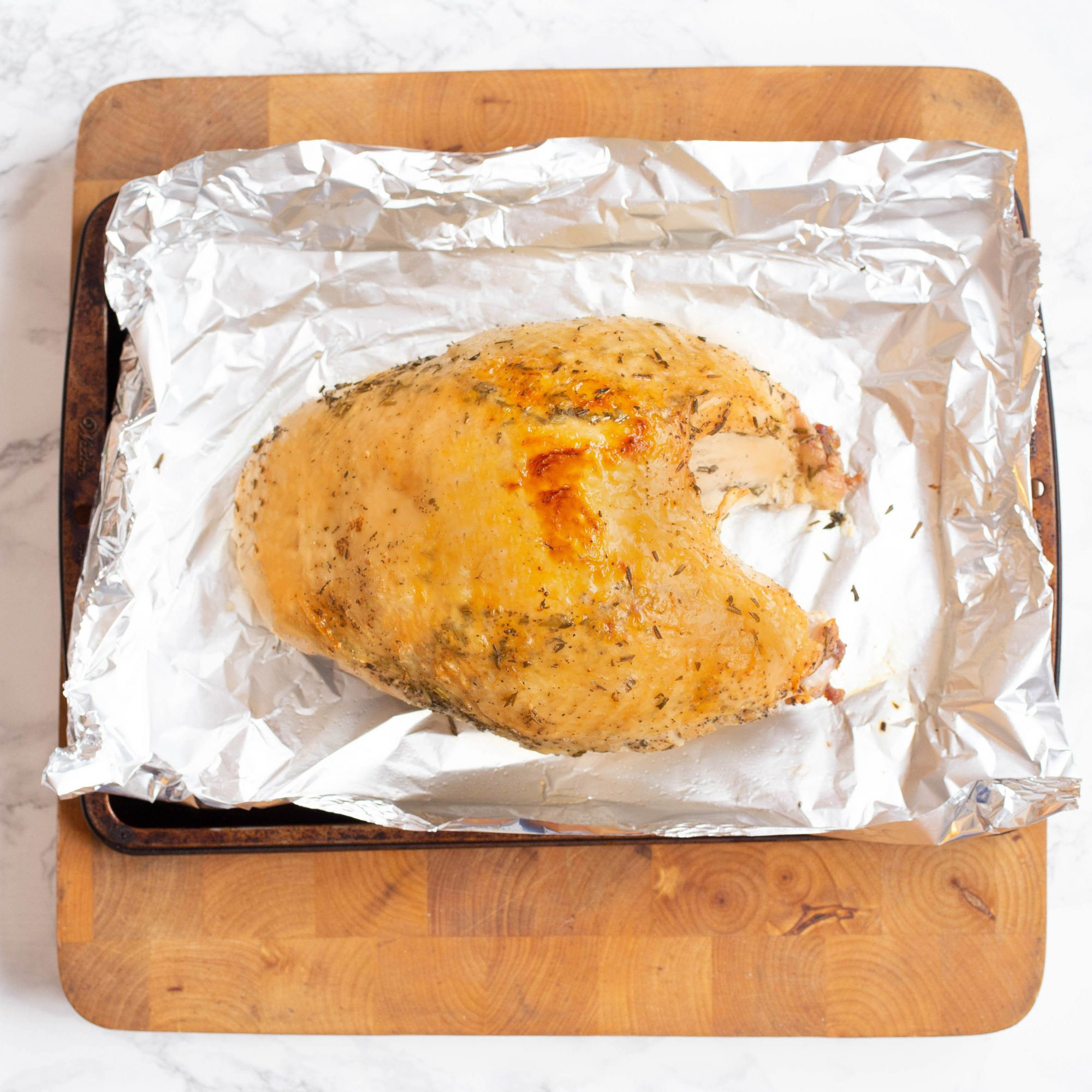 Turkey breast on a baking sheet with aluminum foil with a nice browned color on the skin