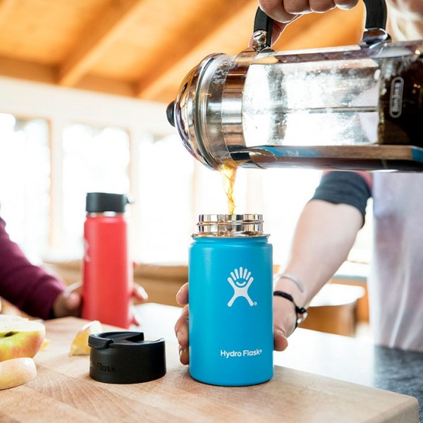 pouring coffee from a french press into a Hydro Flask