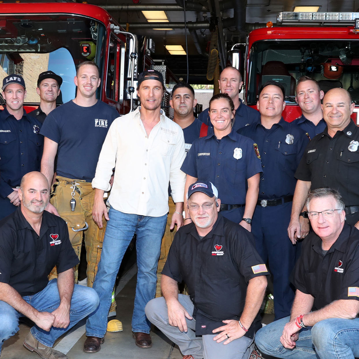 Matthew McConaughey posing with fire department