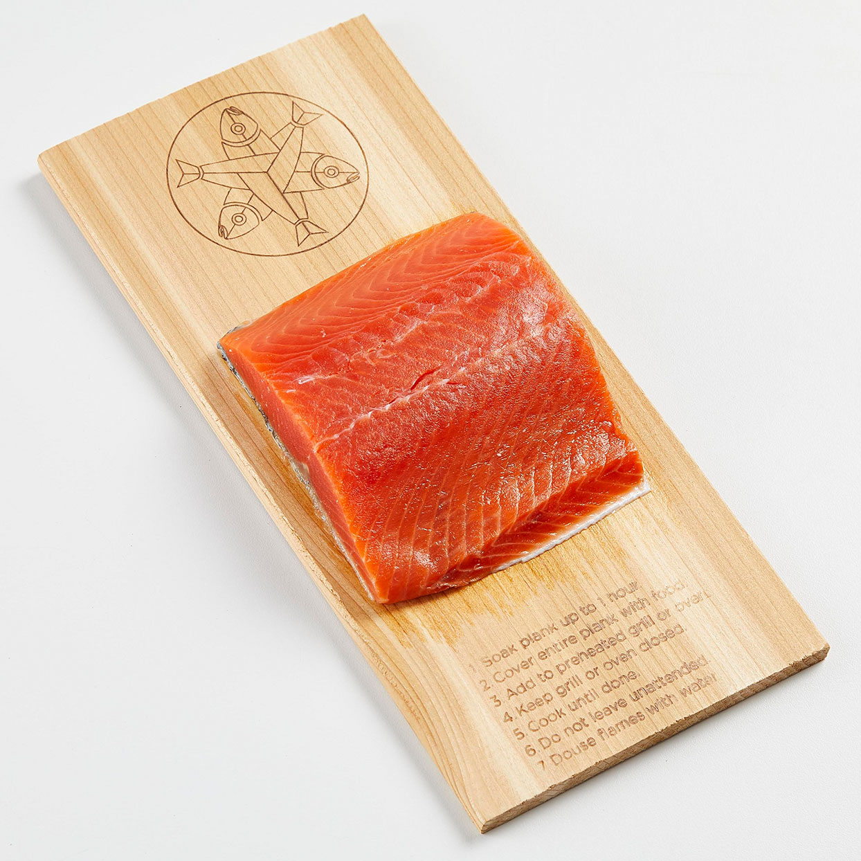 frozen Alaskan Sockeye Salmon fillet on a wood plank