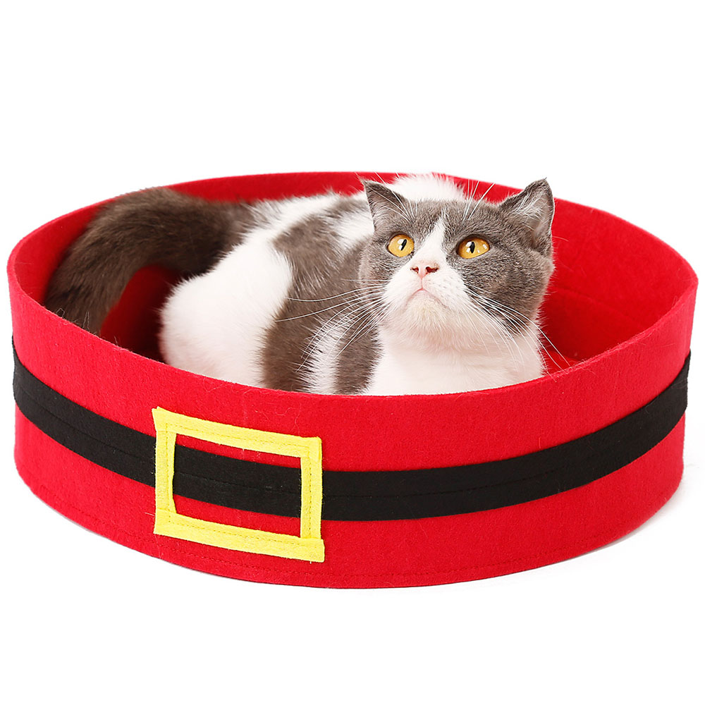 cat lounging in a cat bed that looks like Santa's mid-section/belt