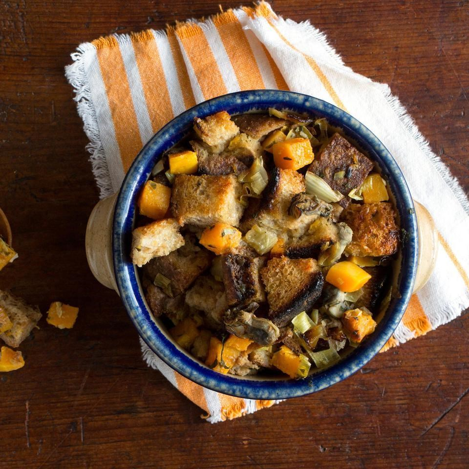 Squash & Oyster Stuffing in a ceramic dish
