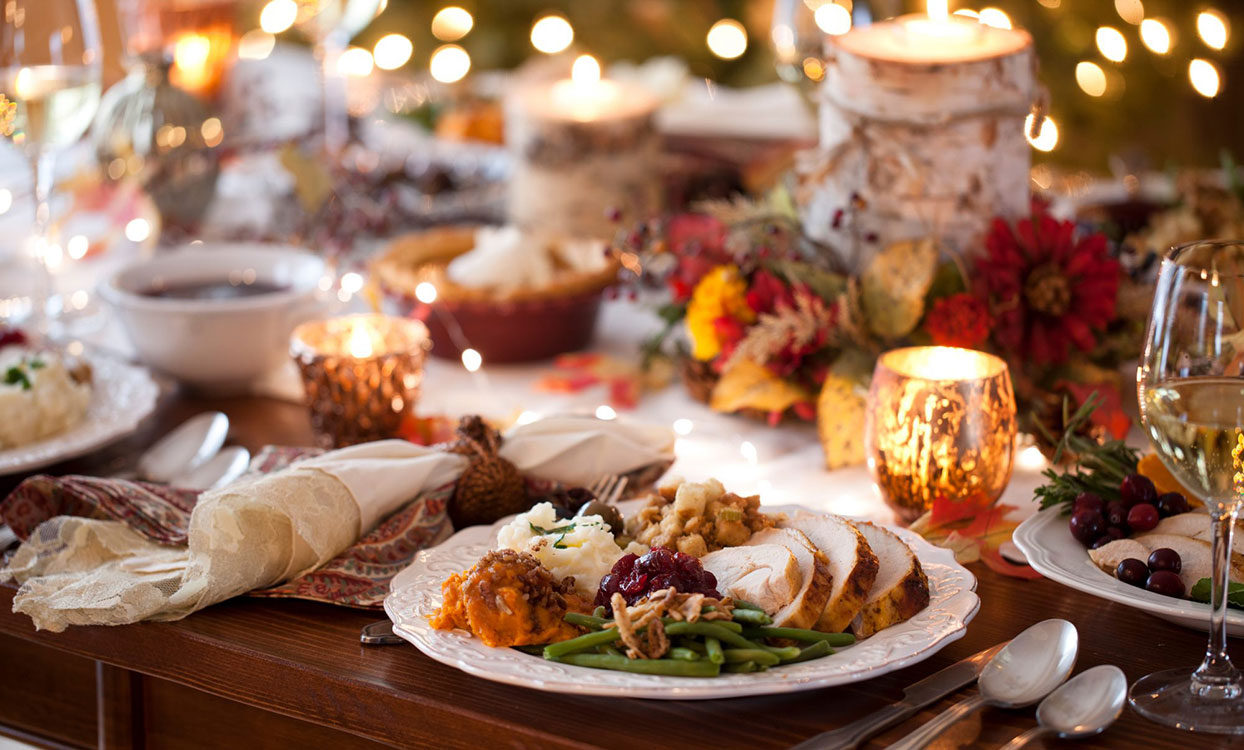 Thanksgiving Dinner on a plate on a fully set table