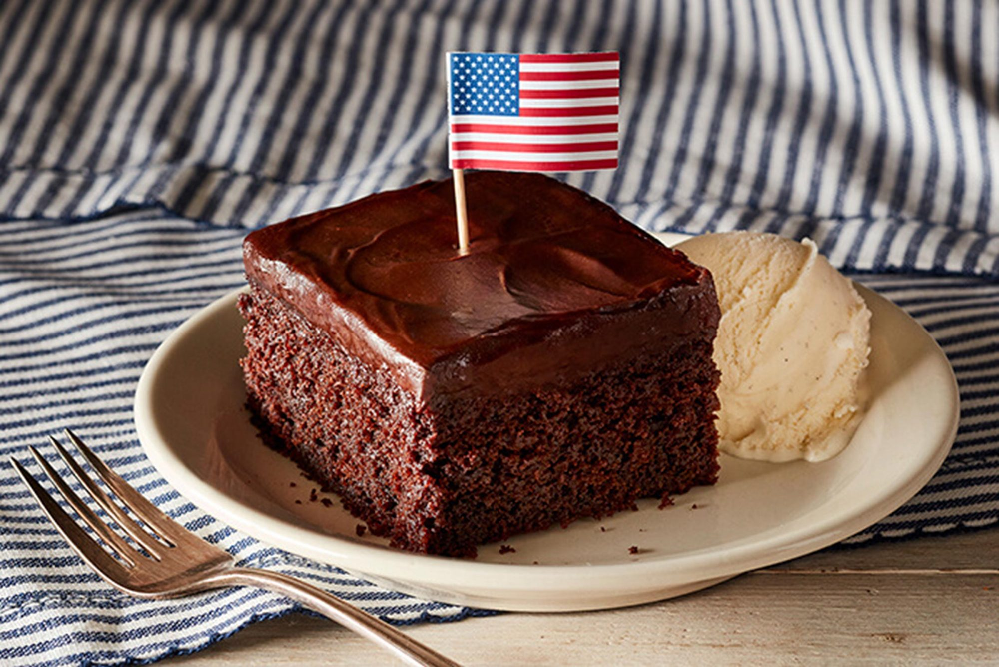 piece of Chocolate Cake with a tiny american flag on top