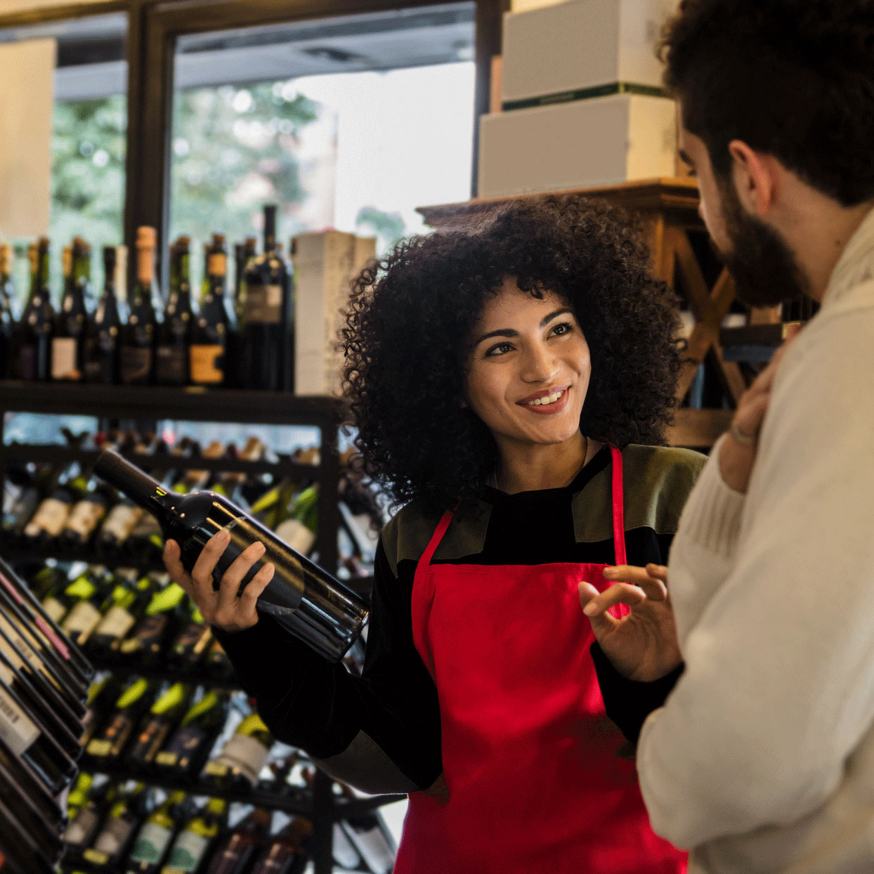 wine salesperson with customer in a wine store