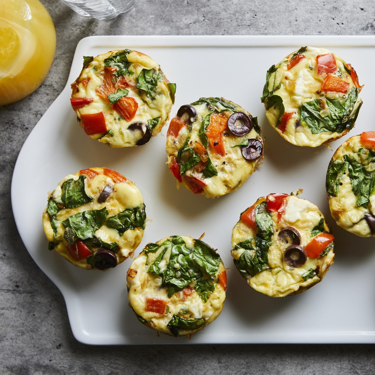Greek Muffin-Tin-Omelets With Feta and Peppers on white plate