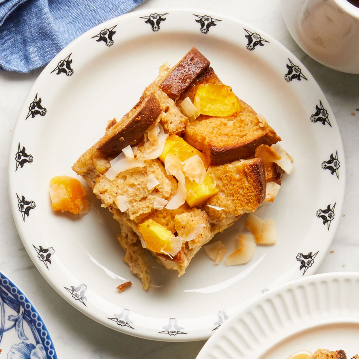 Mango-Coconut-Overnight-French-toast-on-white-plate