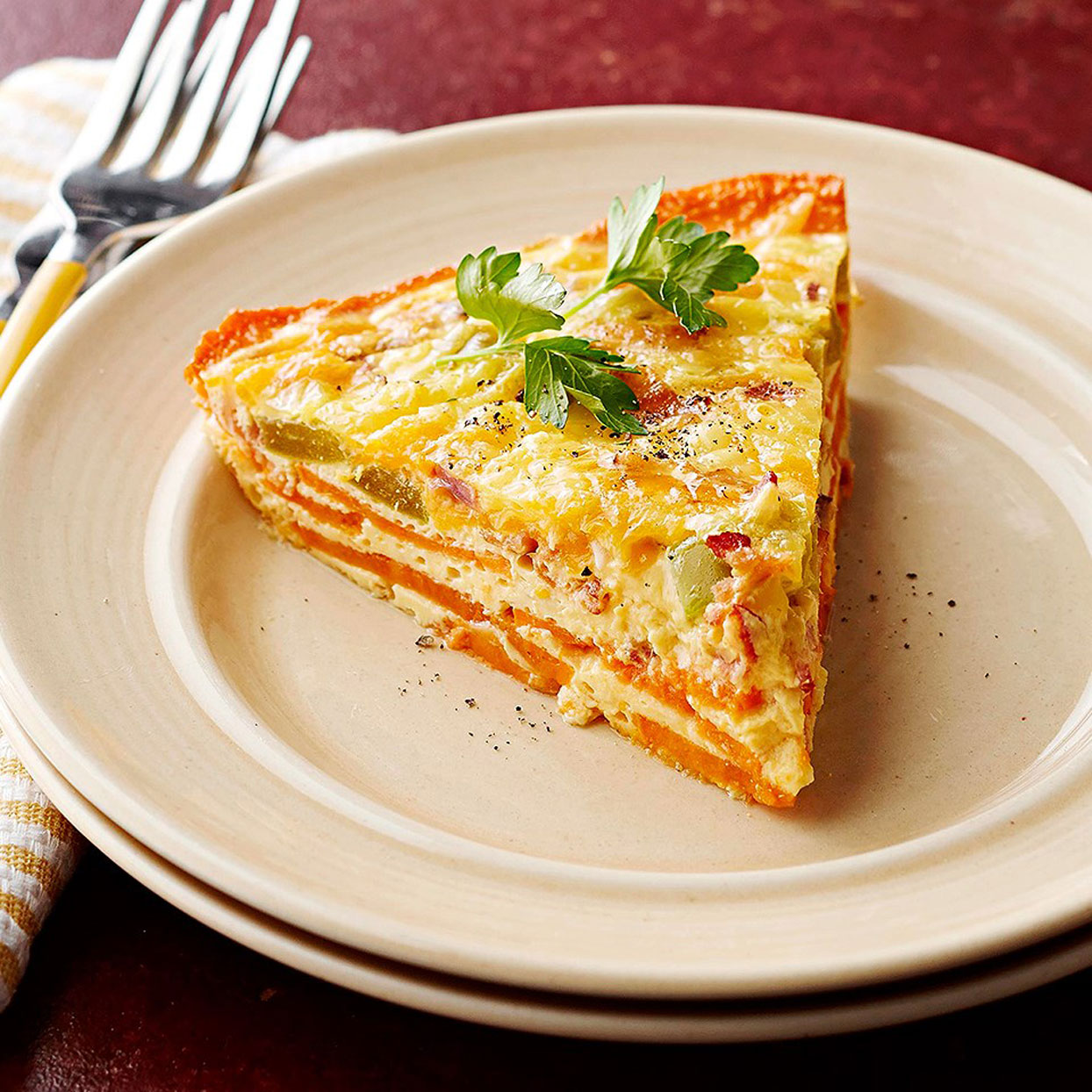 sweet-potato-crusted-quiche-on-white-plate