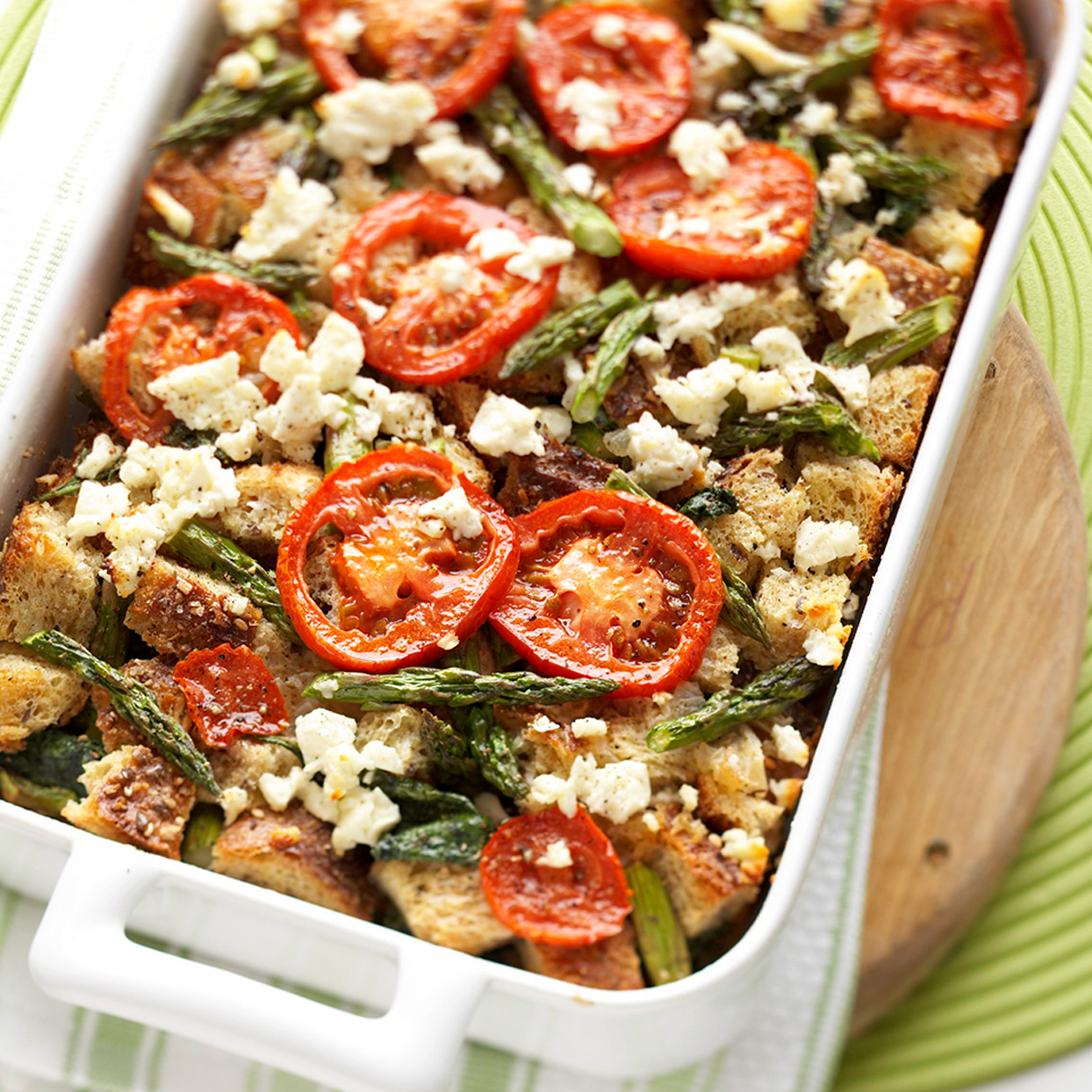 Tomato Spinach and Feta Strata in White Dish