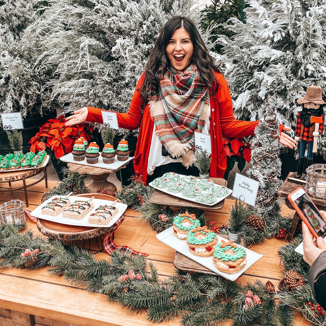Arielle Calderon standing amongst a table of delicious looking holiday treats