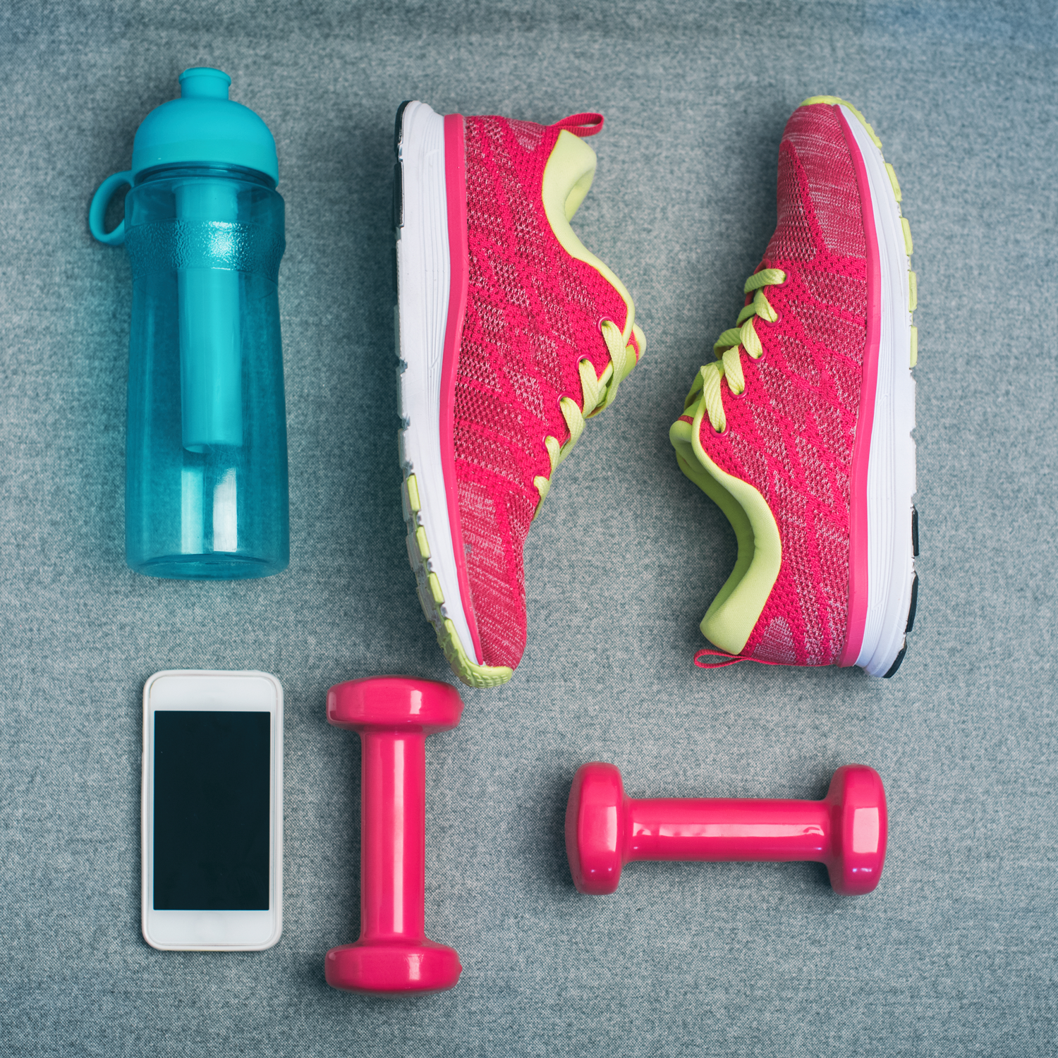 sneakers, water bottle, smart phone and free weights