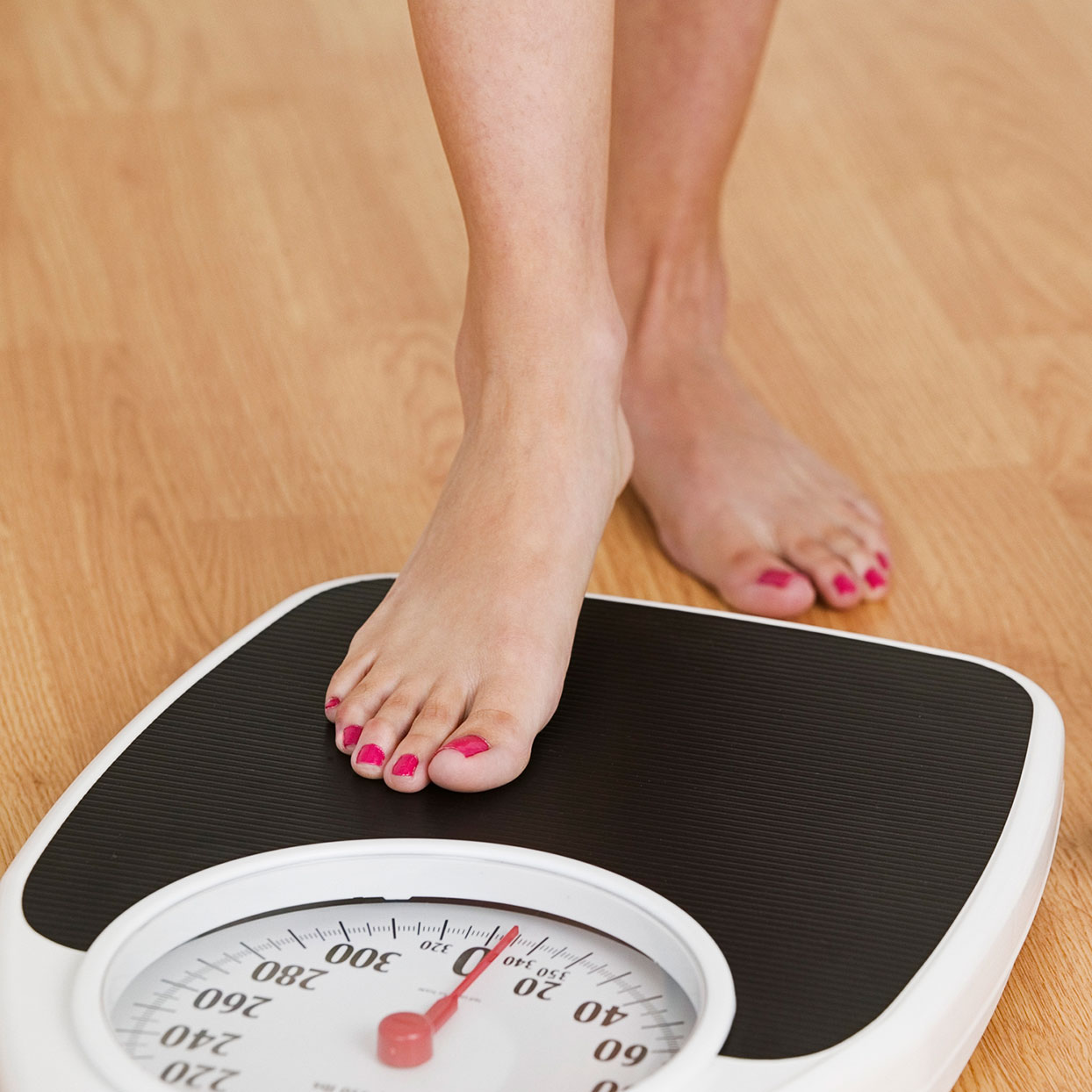 a person stepping on a scale