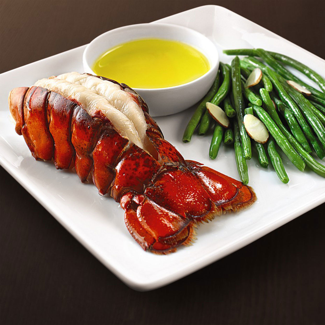 lobster tail with melted butter and green beans