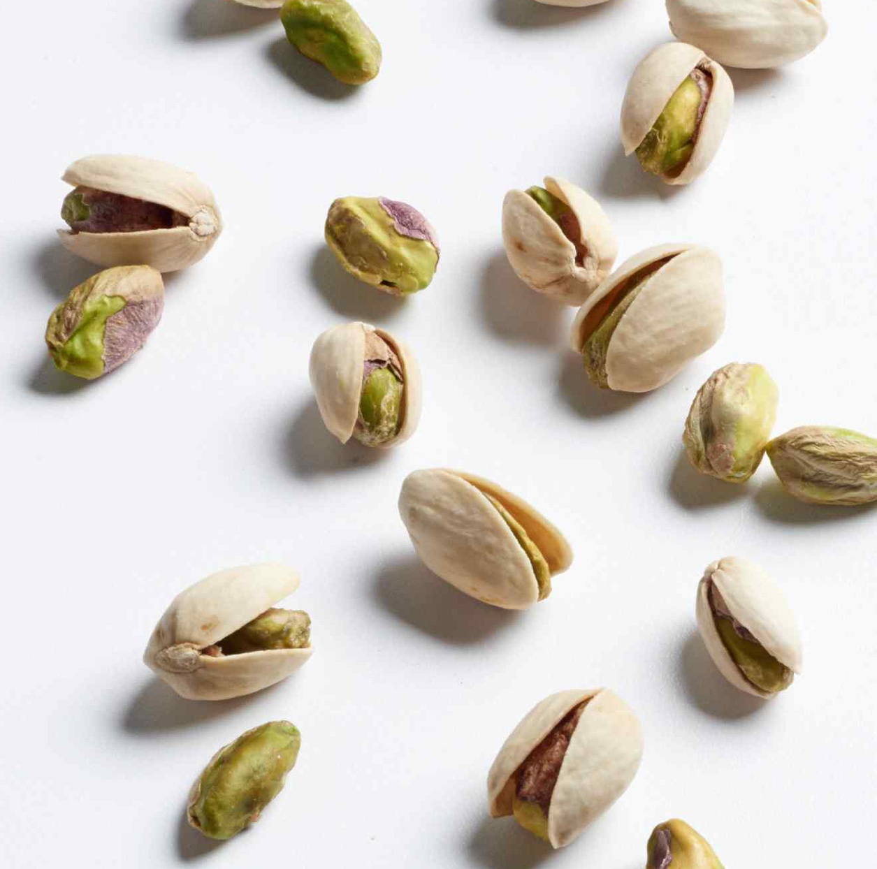 pistachios in shells on a white background