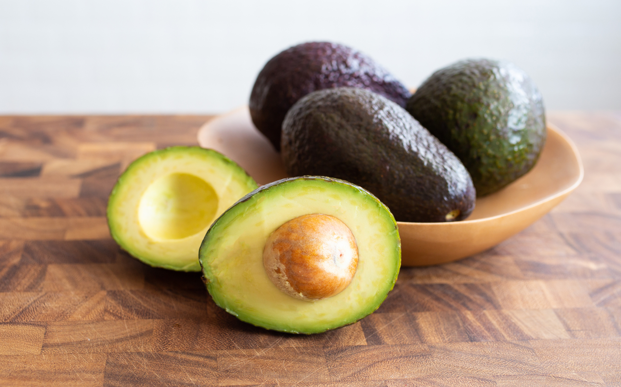 ripe avocados in a bowl
