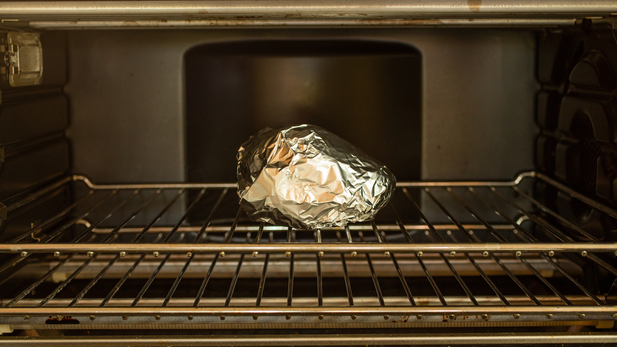 avocado wrapped in foil in the oven