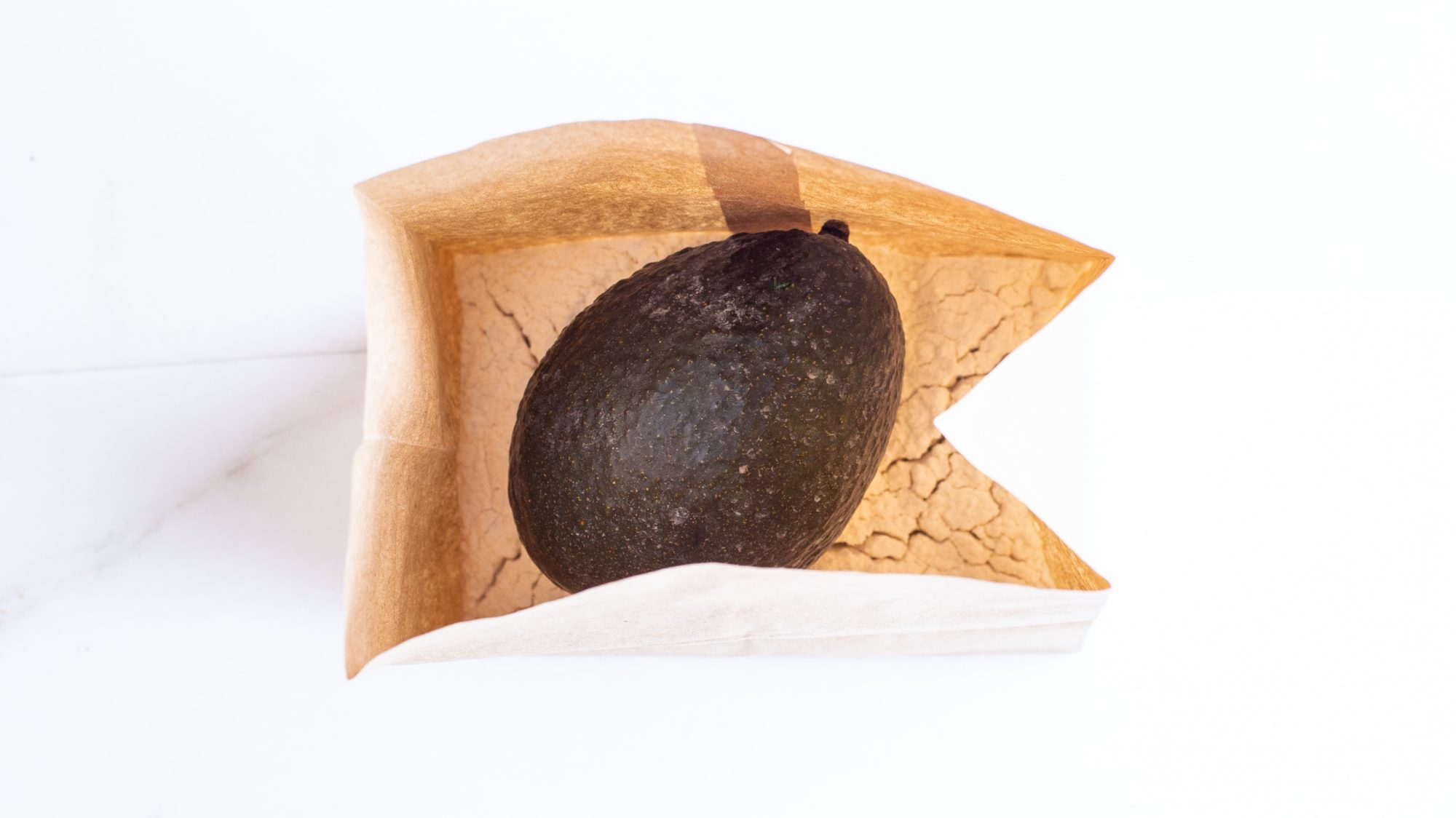 overhead view of avocado and flour in a brown paper bag