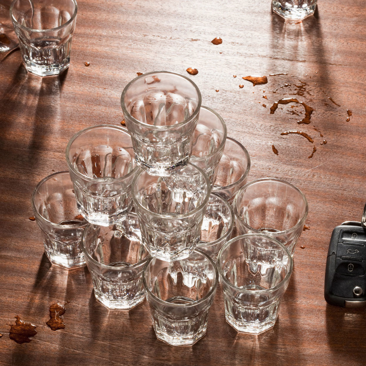several shot glasses all piled on top of each other