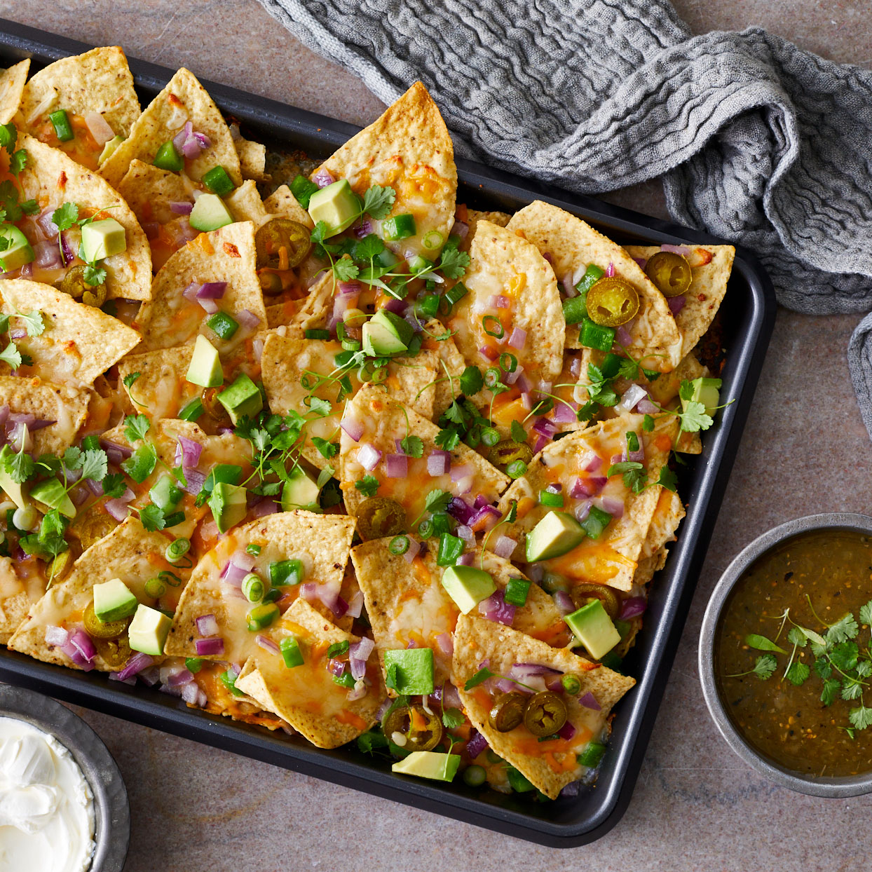 loaded sheet pan nachos with salsa