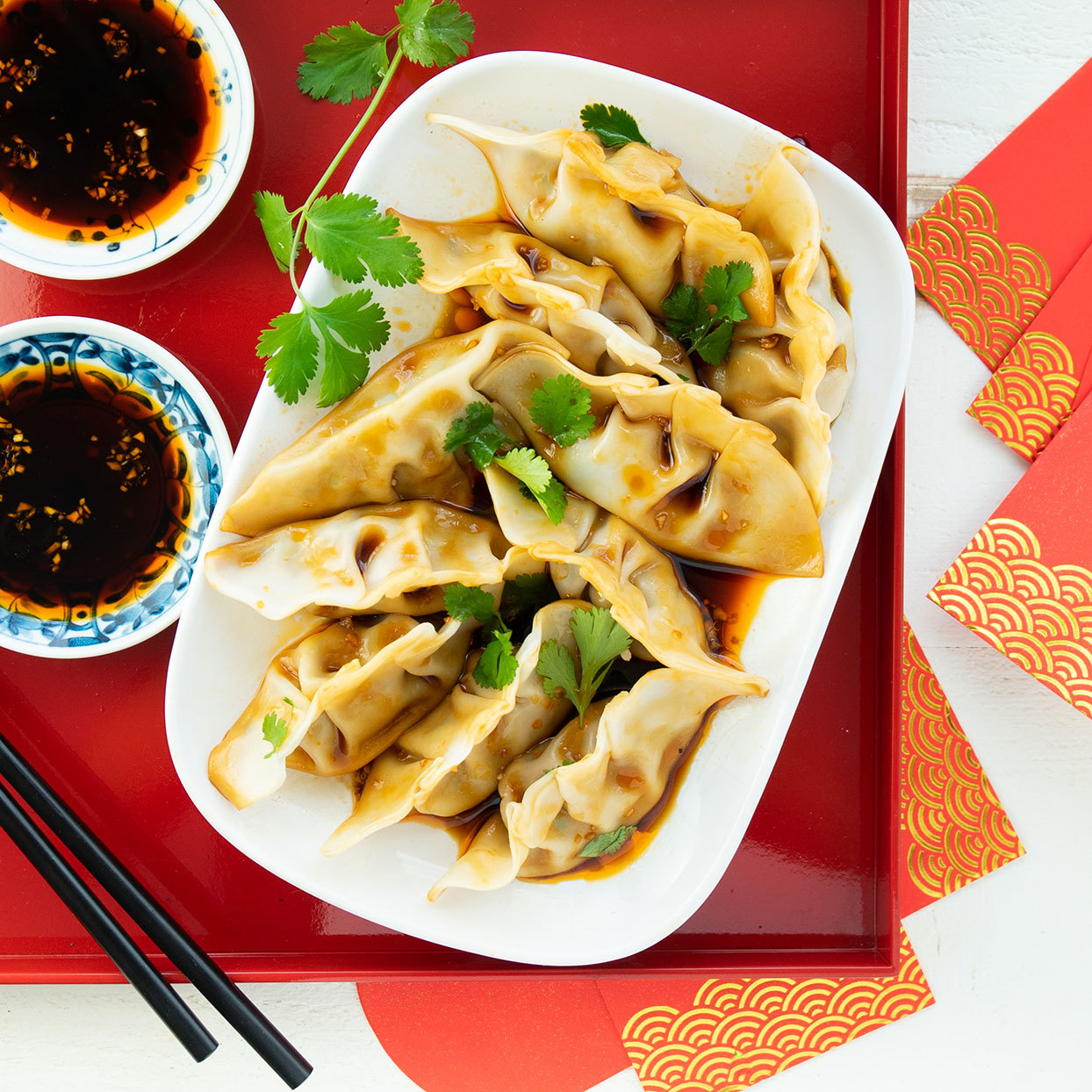 Chicken & Shiitake Dumplings in Tangy Chile-Oil Sauce