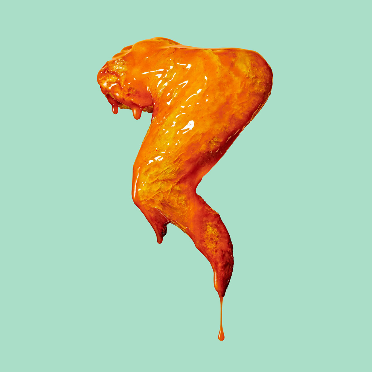 buffalo chicken wing whole against a mint green background