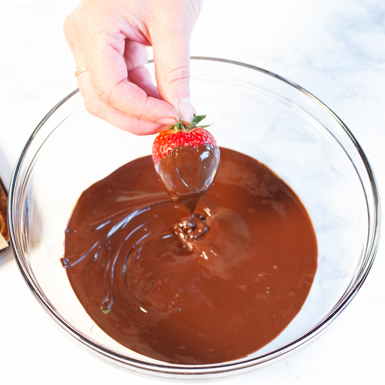 dipping strawberry in chocolate