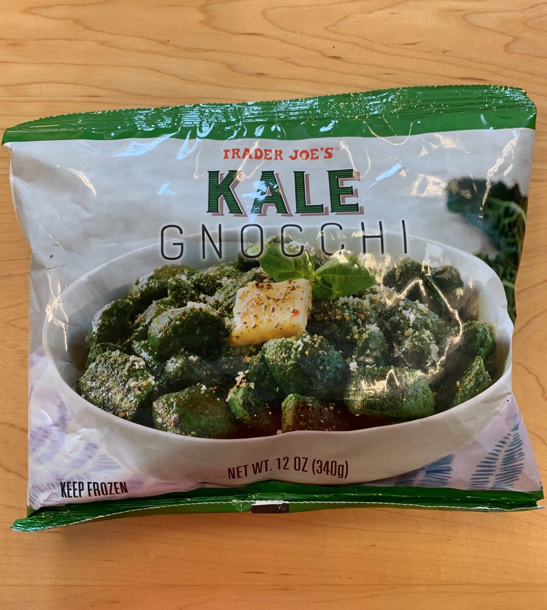 kale gnocchi in the bag on wooden background
