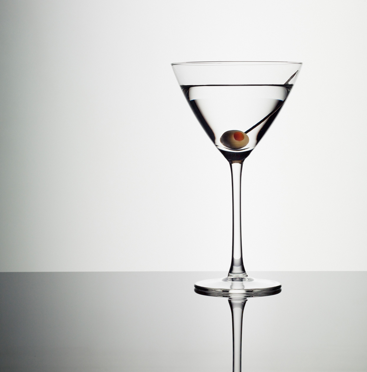 martini with an olive