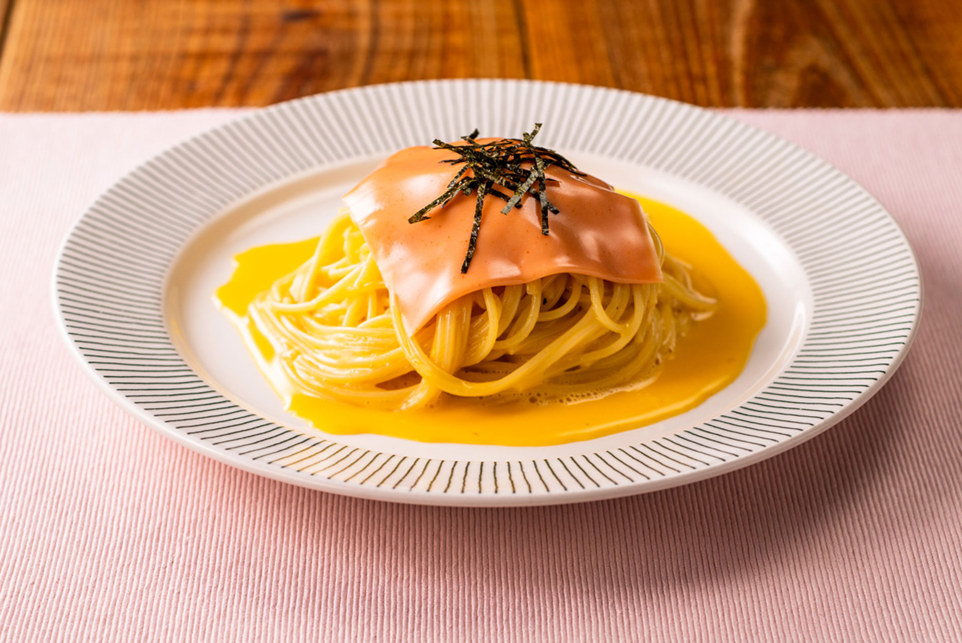 A serving suggestion of a mentaiko mayonnaise slice on noodles