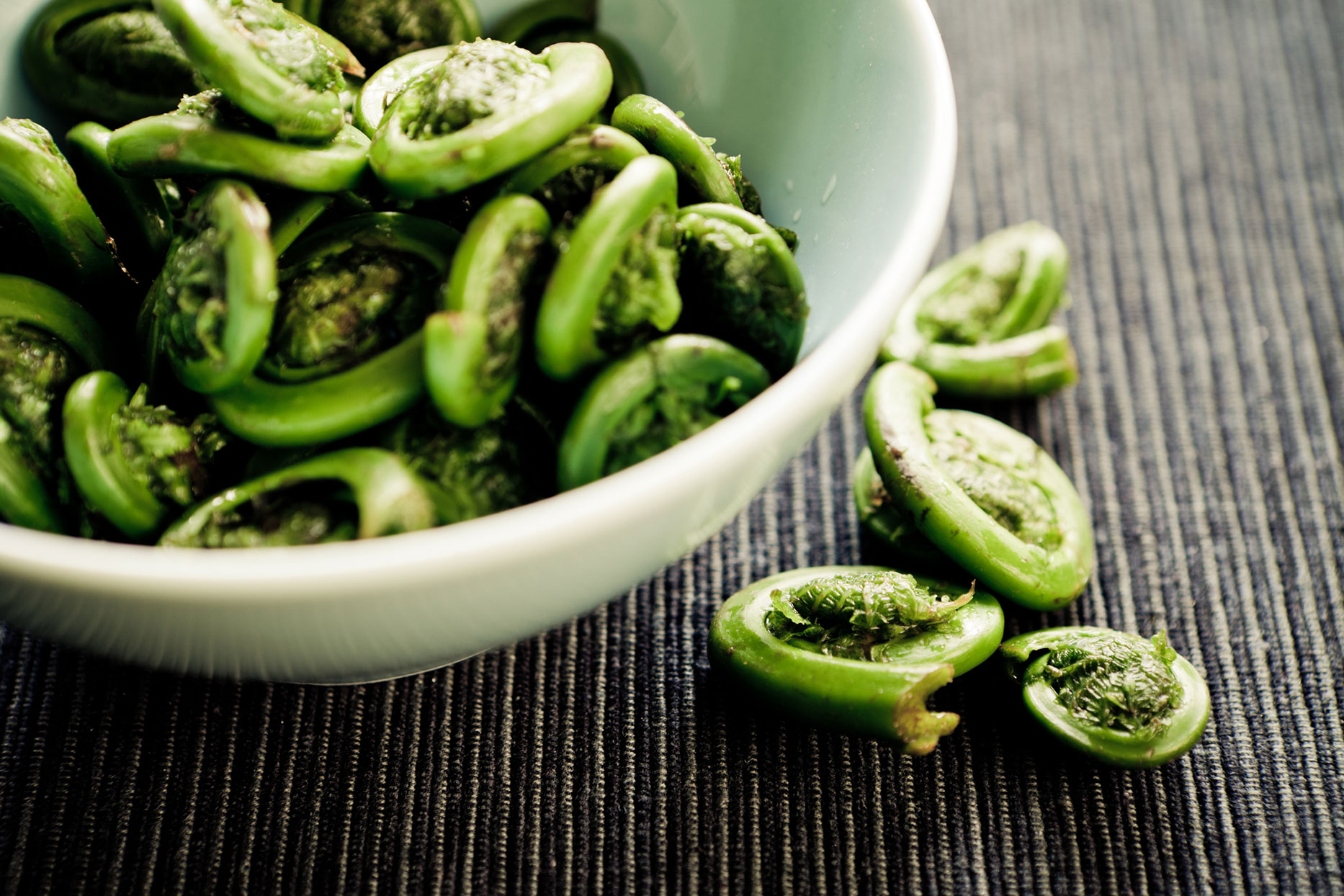 cooked fiddlehead fern in a bowl