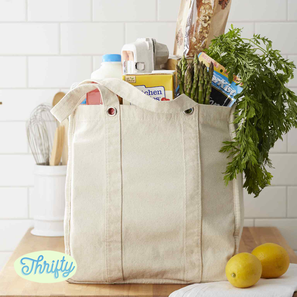 "canvas grocery bag filled with groceries, ""Thrifty"" logo"