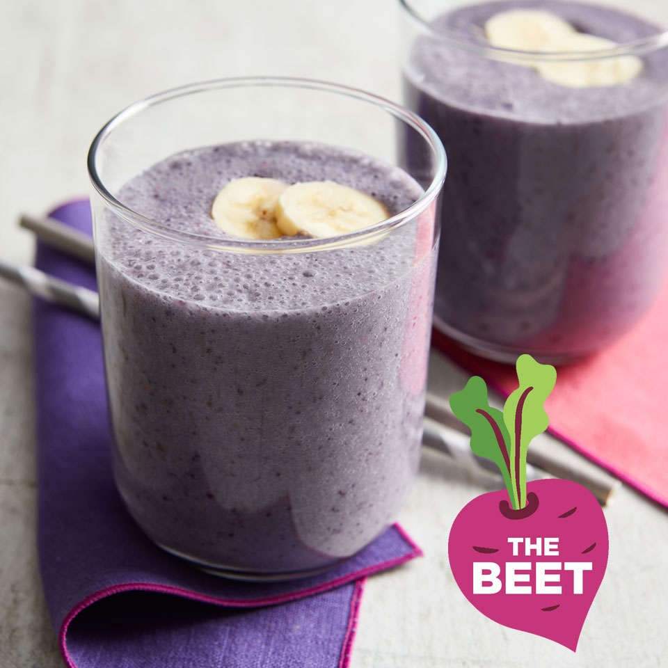 Purple smoothie garnished with bananas - TheBeet