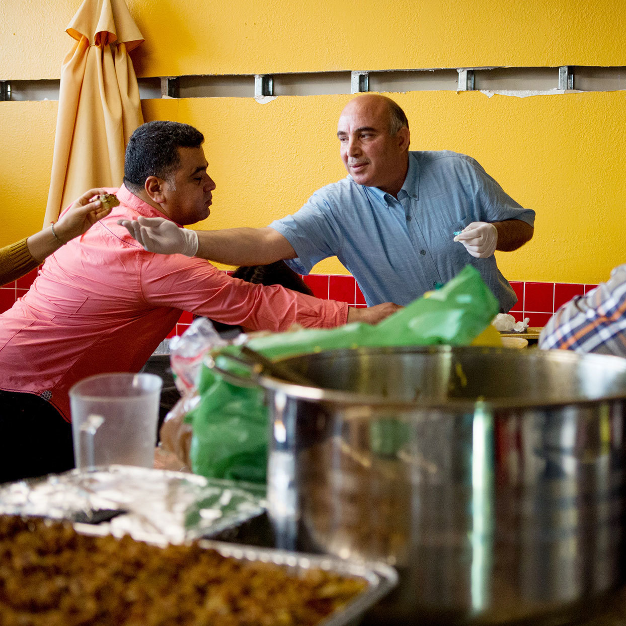 ahmed zarour serving syrian food