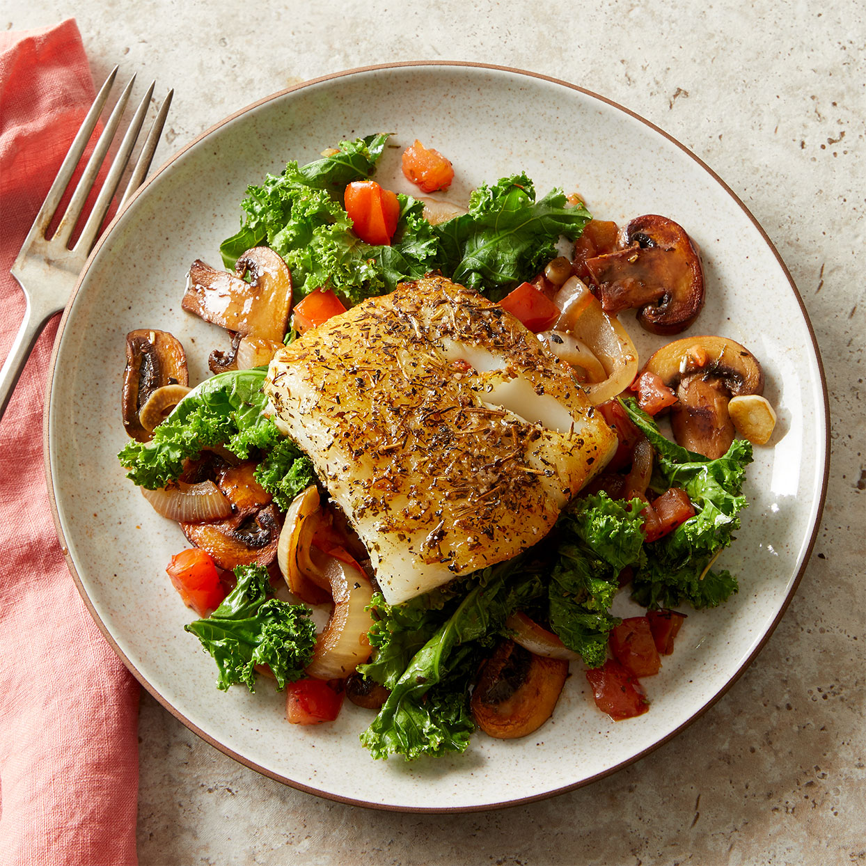 Herby Mediterranean Fish with Wilted Greens & Mushrooms