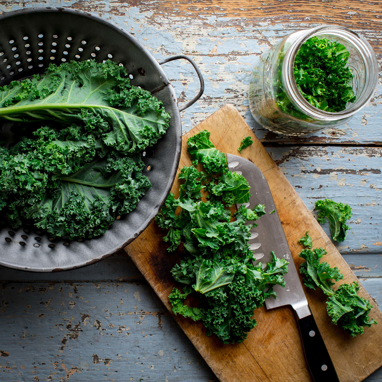 Colander and cutting board with kale