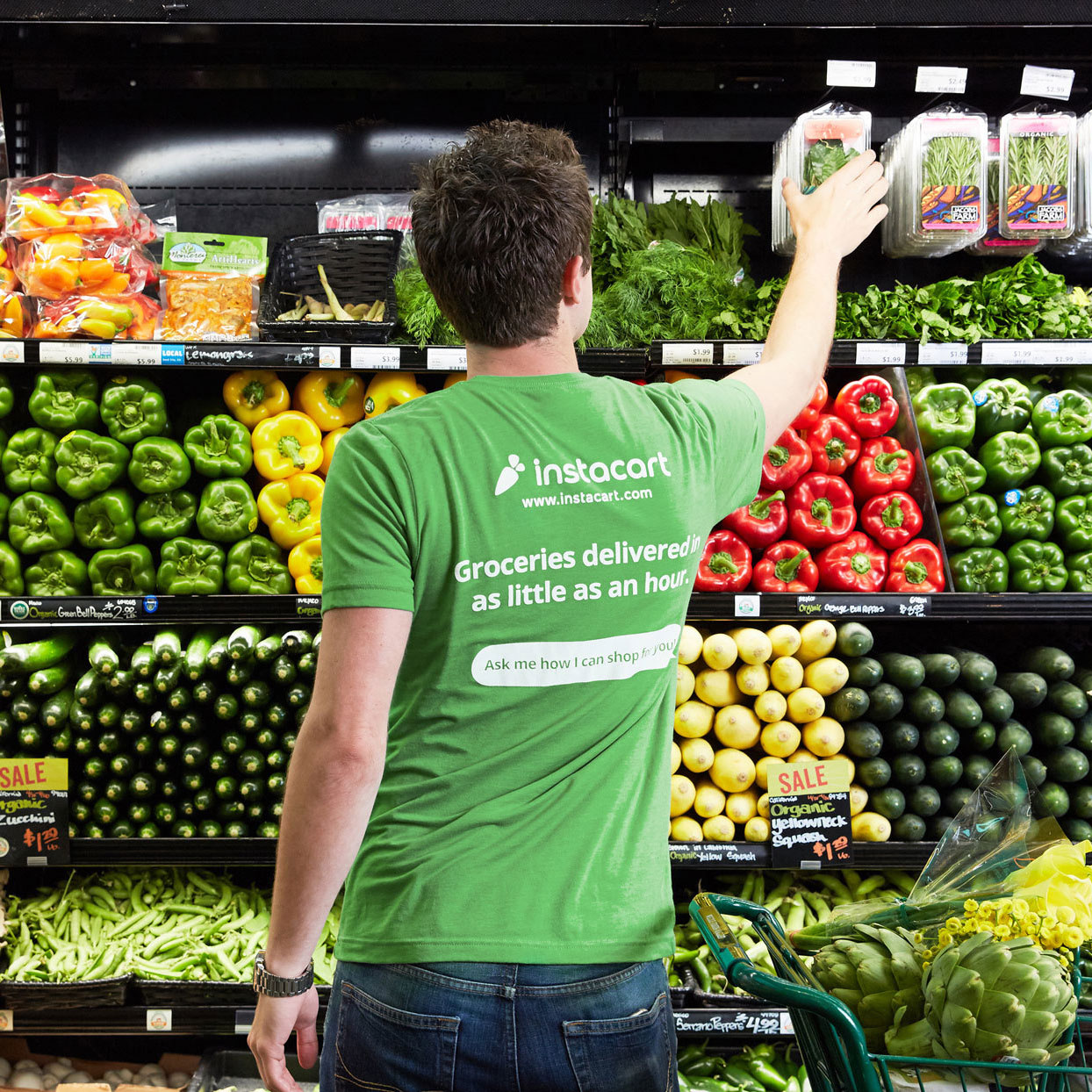 Instacart Shopper picking out produce