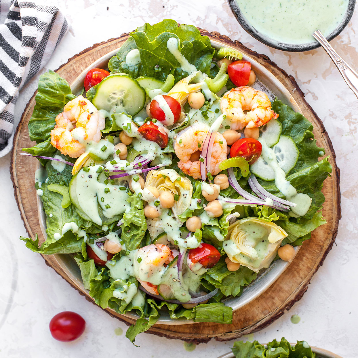 This gorgeous salad combines fresh shrimp, cucumber, artichoke hearts and cherry tomatoes with homemade green goddess dressing. The dressing is beautifully green and creamy with avocado (loaded with good-for-you fats) and fresh herbs. Buttermilk and a dash of rice vinegar add tang.
