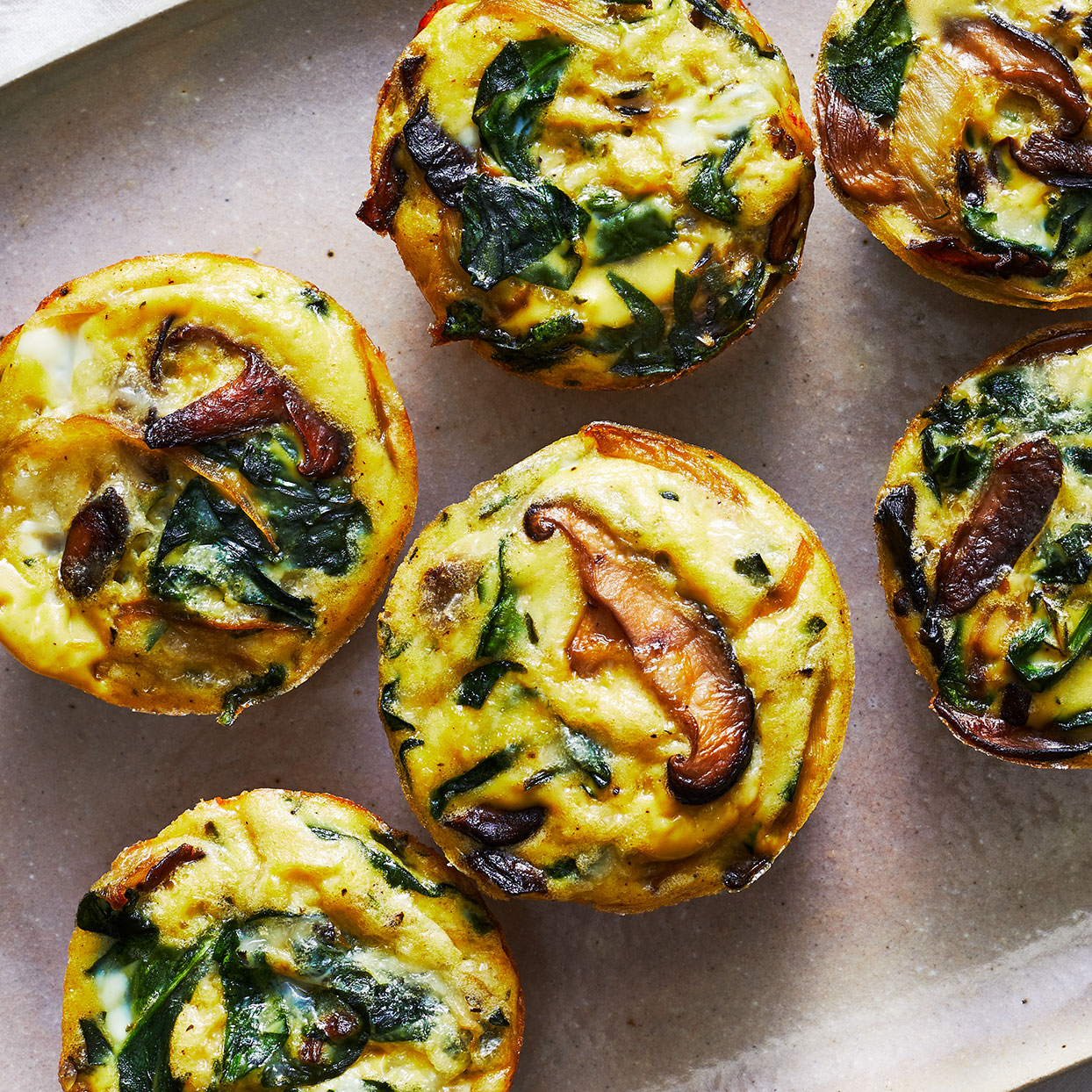 Switch up your morning routine with these easy vegetarian mini quiches. Earthy mushrooms and spinach pair nicely with rich and creamy Gruyère cheese. Serve them on a platter with a fresh fruit salad for a simple weekend brunch. Source: EatingWell.com, March 2020