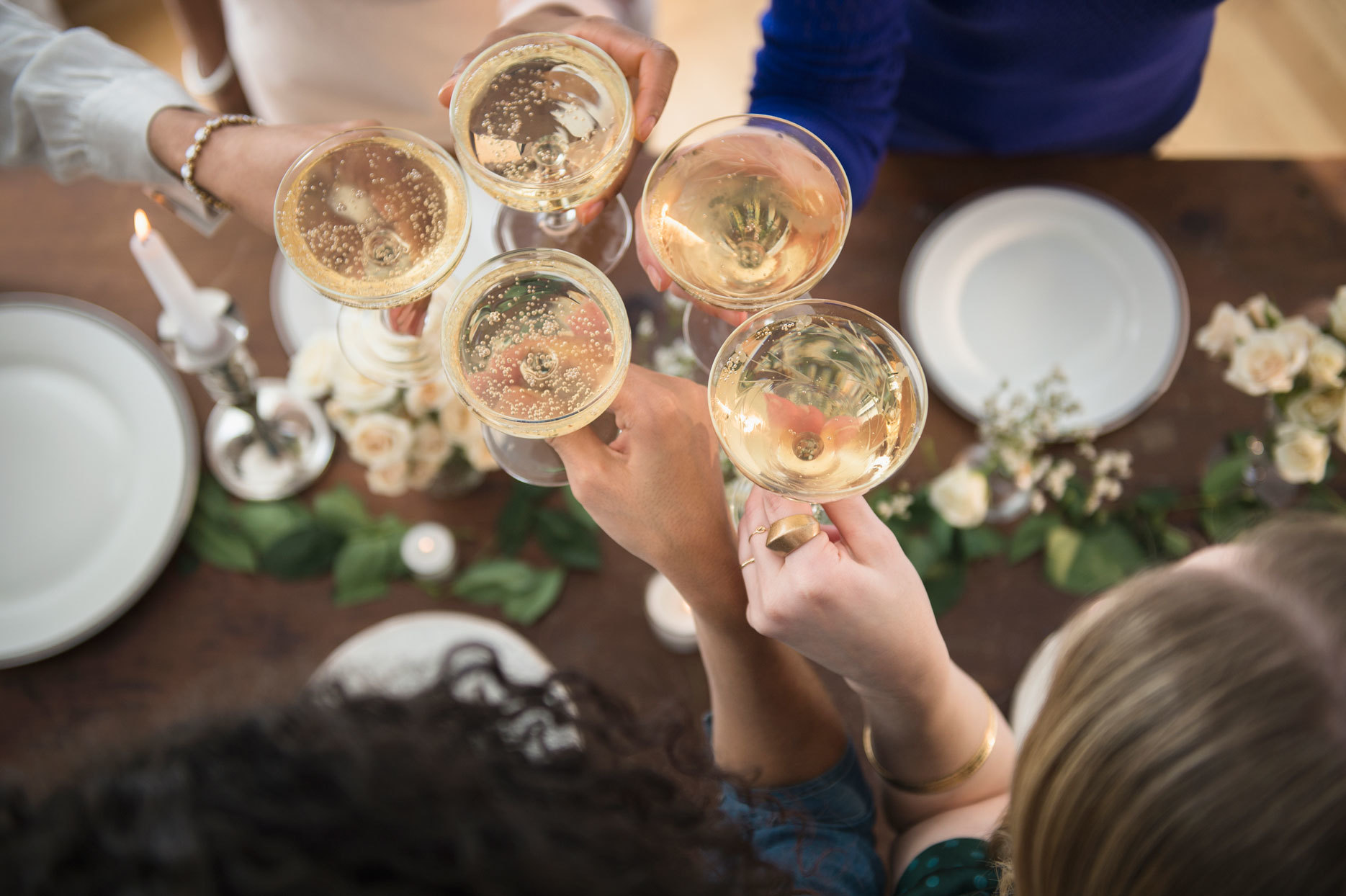 People toasting with champagne glasses